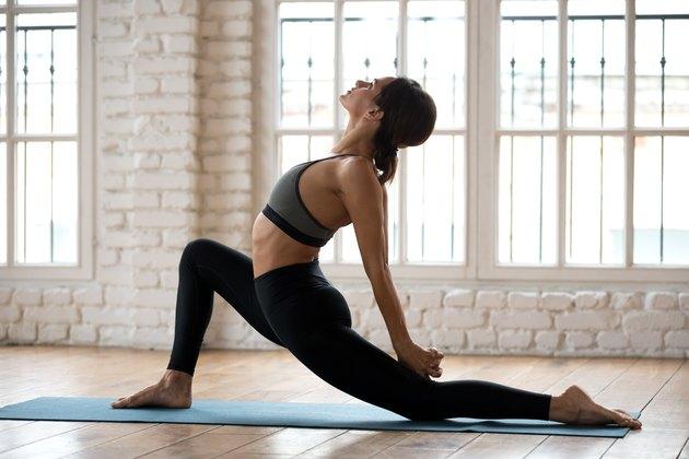 Young attractive yogi woman practicing yoga, Horse rider pose