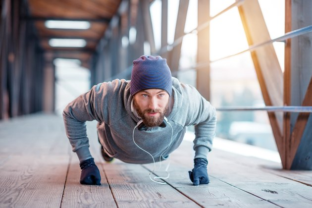 Man doing push-ups outside
