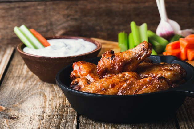 Roasted chicken wings with carrots, celery sticks and dipping sauce