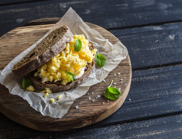 Scramble egg sandwich on rustic wooden background