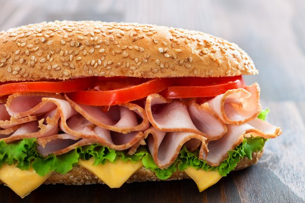 Delicious sandwich with tomato, cheese, lettuce and turkey