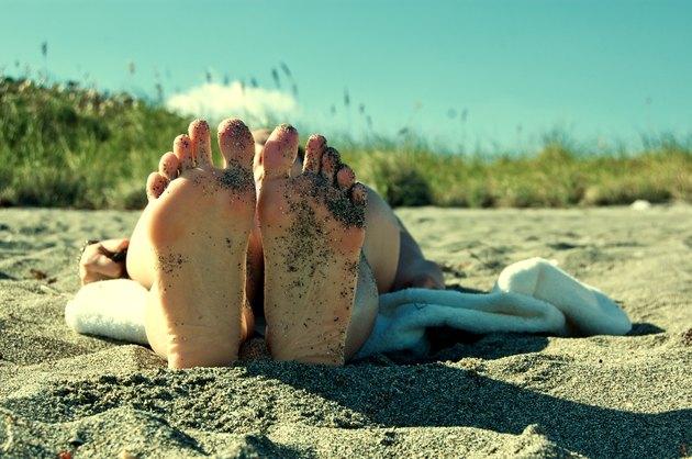 Bottom of feet on Blowing Rocks Beach