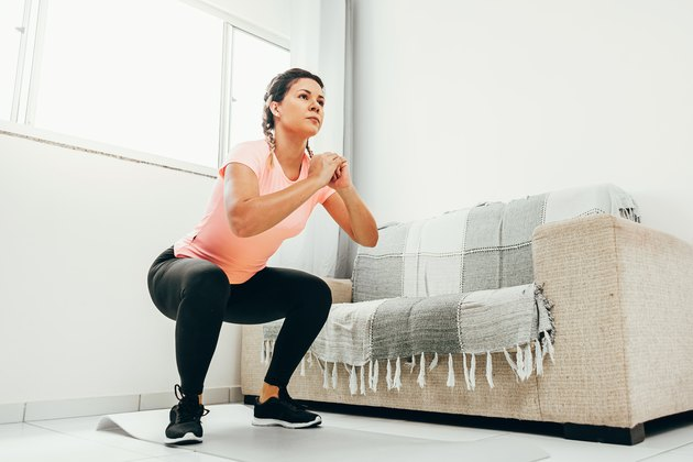 Woman doing squat exercise.