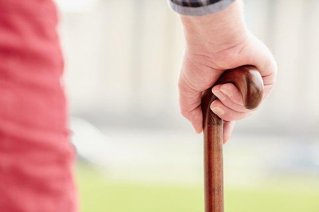 Hand with cane closeup
