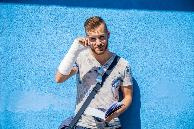 Portrait of Handsome Young Man with Broken Arm