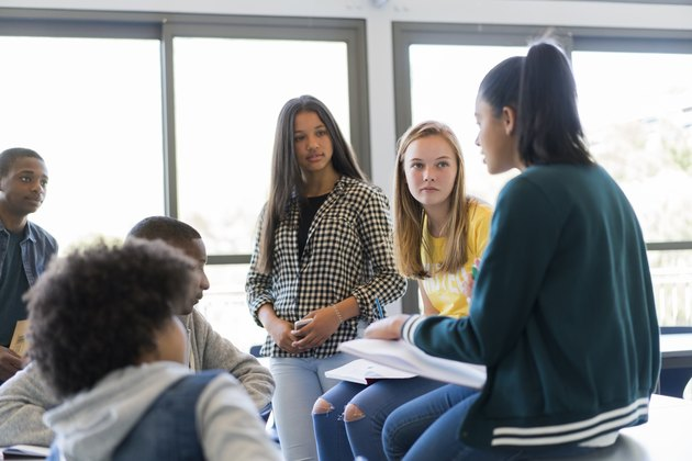 Multi-ethnic students discussing in classroom