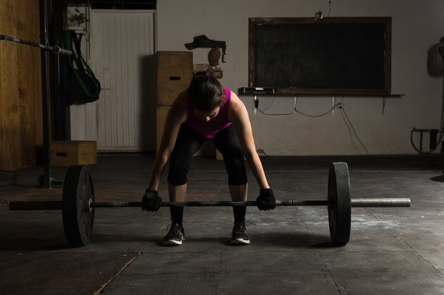 Woman getting ready for a deadlift