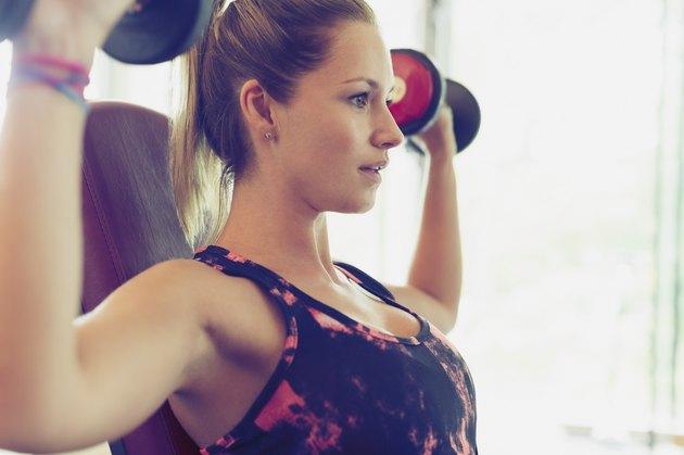 Woman performing shoulder press.
