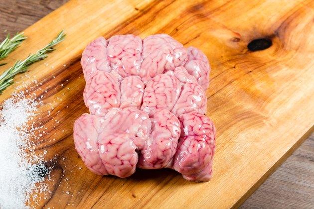 Raw lamb brains on chopping board
