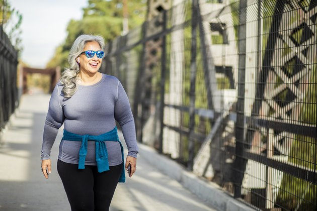 Woman Going Across a Bridge, Walking 20 Minutes a Day to Lose Weight