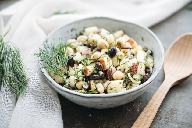 Bean salad, with black beans, chickpea, apple, spring onion and dill