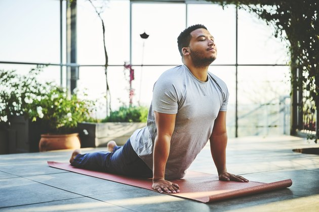 Young man with IBS practicing yoga to reduce anxiety