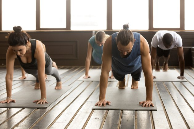 Group of young people standing in plank pose