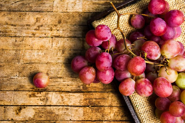 Fresh grapes on a rustic wooden background
