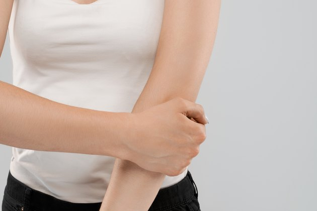 Woman suffering from pain in elbow.