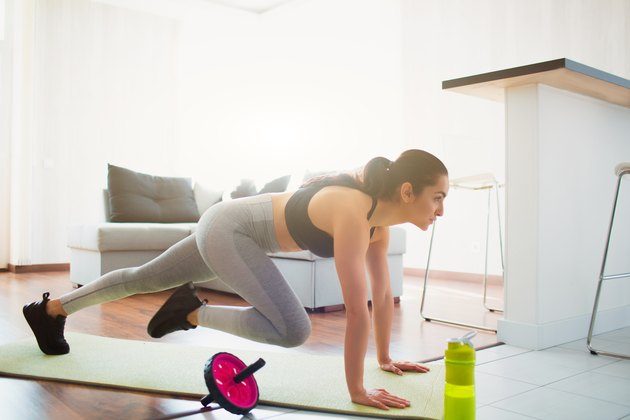 Woman doing mountain climber exercise for 20-minute hiit workout