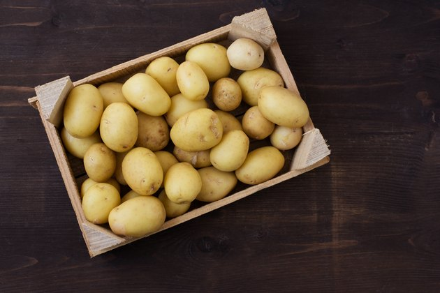 Overhead view of a crate of fresh potatoes