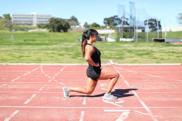 a Fit young woman training at the track.