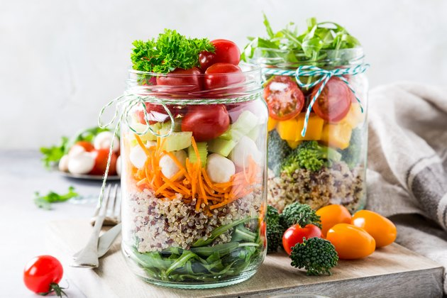 healthy lunch recipe of salad in glass jar with quinoa