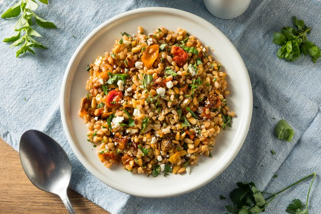 Top view of a healthy homemade farro and tomato salad