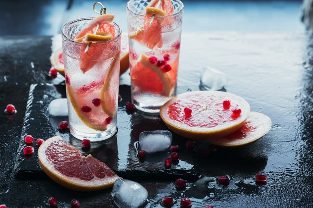 Grapefruit and pomegranate cocktail or mocktail, refreshing summer drink with crushed ice