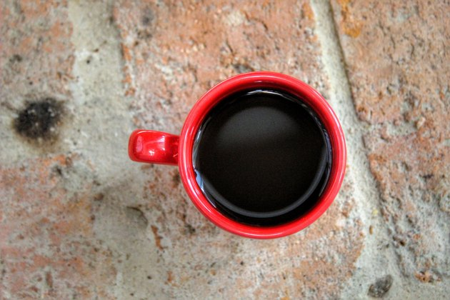 Directly Above Shot Of Black Coffee In Red Cup