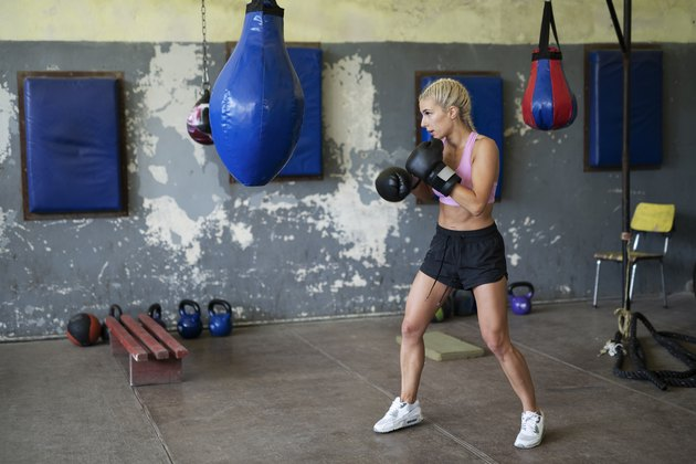 Young woman boxing indoor.