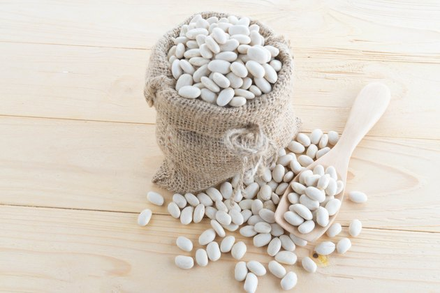 white bean in hemp sack on sack background