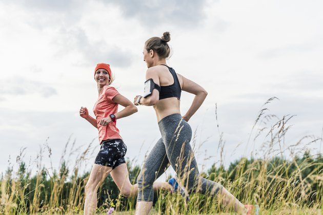 Two women running in the countryside