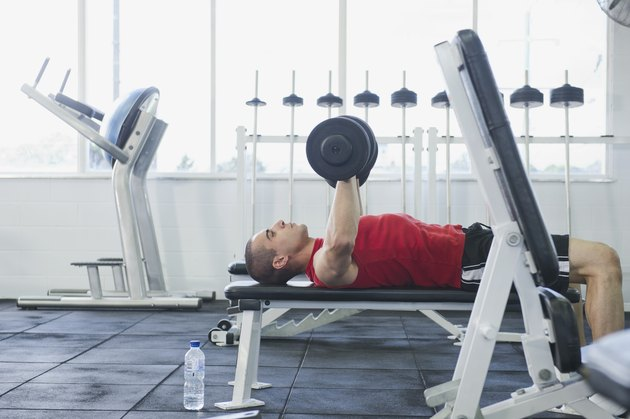 Middle Eastern man exercising in health club