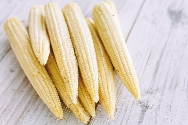 Fresh Baby corn on wooden background