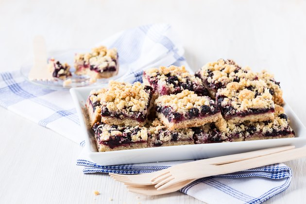 Homemade currant cornmeal crumble bars with streusel topping