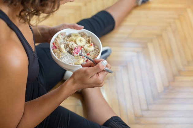Young woman eating a oatmeal after a workout