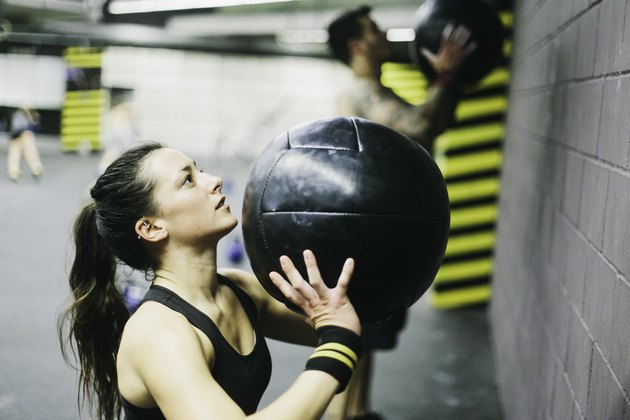 Young woman in high intensity fitness session.