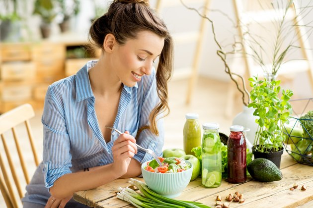 Woman eating healthy salad for daniel fast