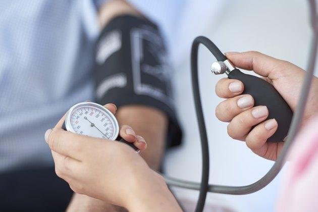 nurse measuring a patient's blood pressure