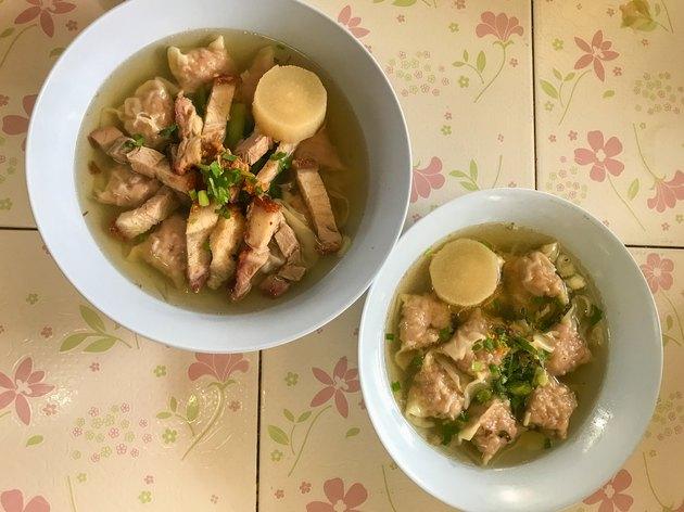 hot soup crispy pork and wontons on bowl, Thai Food