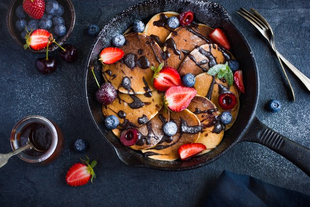 pancakes with fresh berries and chocolate sauce for cast iron breakfast