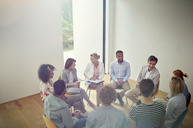 People talking in a circle in group therapy session