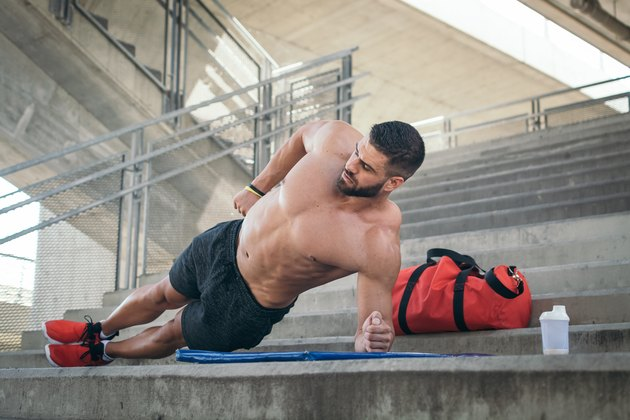 Man doing side plank for six-pack abs without crunches