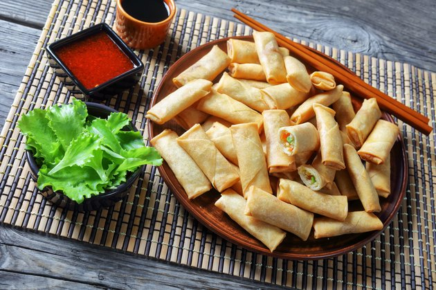 deep fried crispy bite-sized chinese spring rolls with cabbage, carrots and green peas fillings