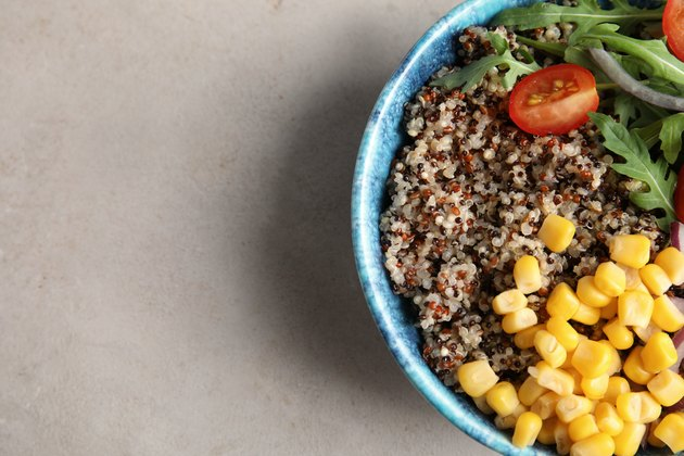 Healthy quinoa salad with vegetables in bowl to illustrate quinoa nutrition and carbs