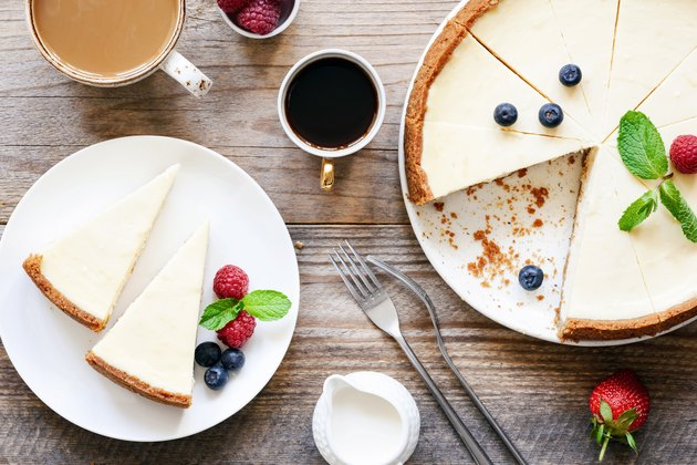 Homemade no-bake cheesecake and coffee on wooden table