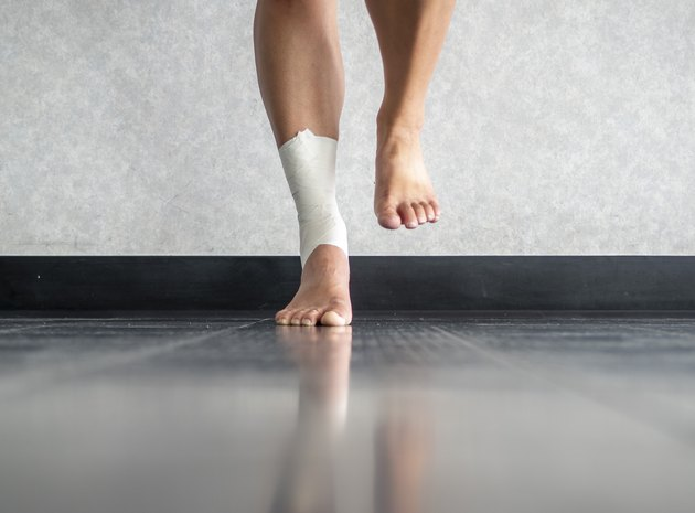 Athlete balancing to regain proprioception on sprained ankle