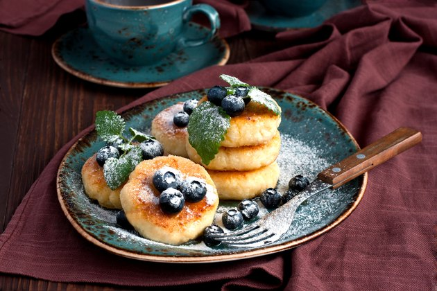 a plate of cottage cheese pancakes with blueberries