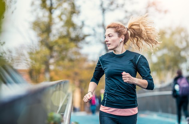 Female Athlete Running Outdoors