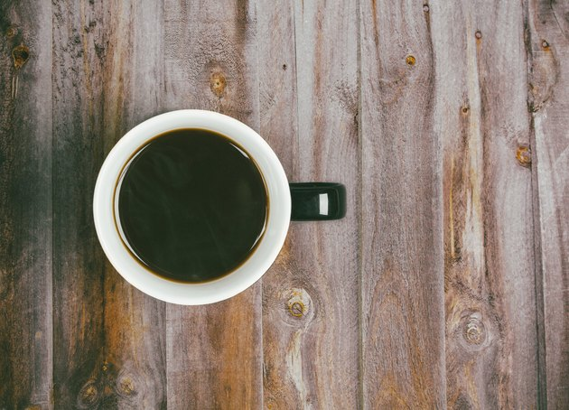 Directly Above Shot Of Black Coffee On Wooden Table