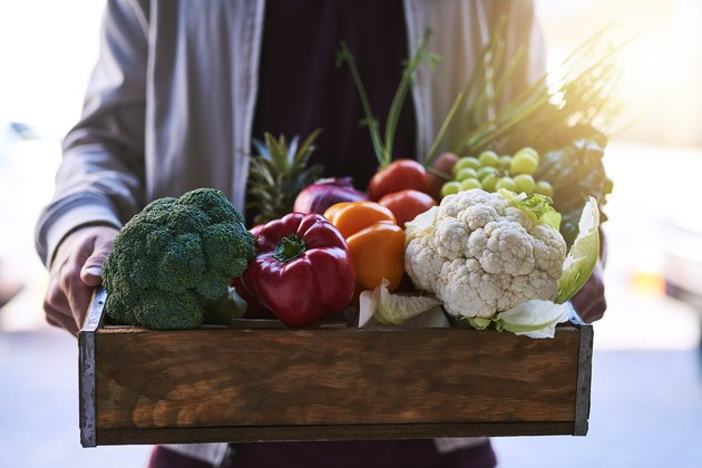 Fruit and vegetables in wooden box