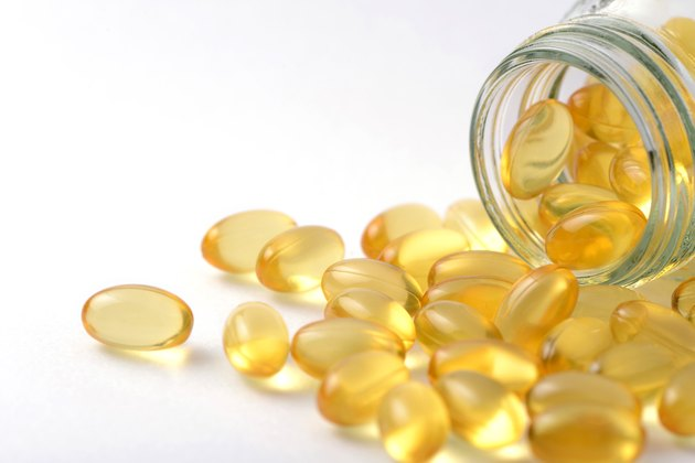 Fish oil and Evening Primrose capsules pills and container