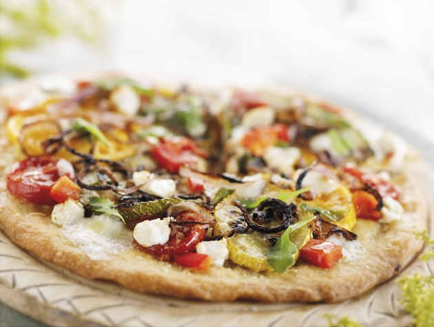 Vegetable Pizza on a Round Cutting Board